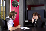 Male boss angry at late female employee