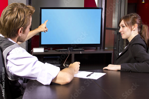 Business team watching a blank tv screen