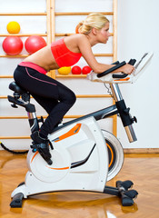 attractive woman on stationary bike