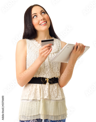 Young girl with credit card and tablet PC