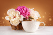 Bouquet of peonies with a cup