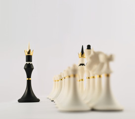 Black chess king opposite to white ones