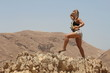 Beautiful blond stretching at the Desert