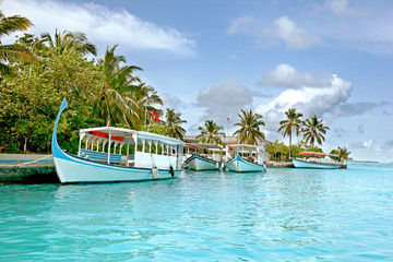 boats on a tropical resort in maldives
