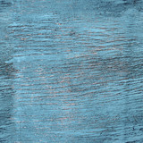 Seamless texture of cracked paint on a wooden surface