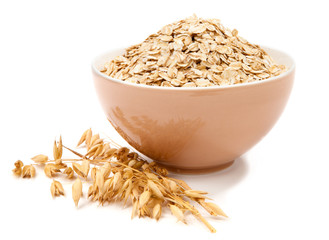 Rolled oats in a bowl isolated on white