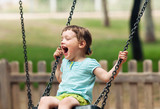 Happy baby on swing