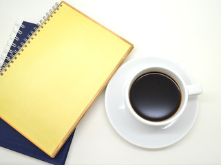 notebooks and a cup of coffee on white background