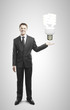 businessman holding lamp
