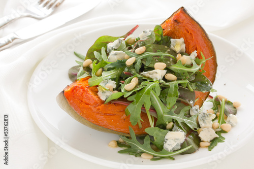 Pumpkin salad with arugula and cheese.
