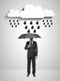 businessman standing with umbrella