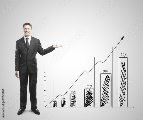 businessman shows graph