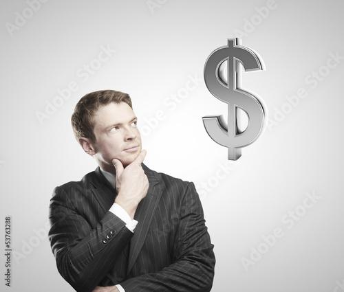 man looking on doollar sign