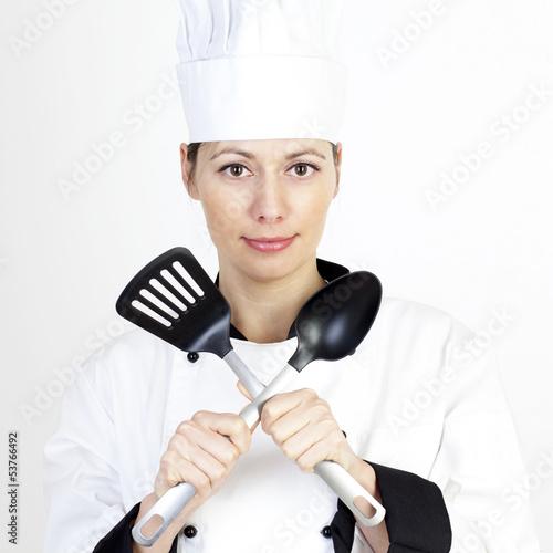 Weiblicher Koch mit Kochgabel