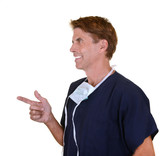 handsome doctor wearing navy blue scrubs pointing