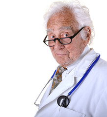 Kindly mature doctor wearing a white lab coat and blue stethosco