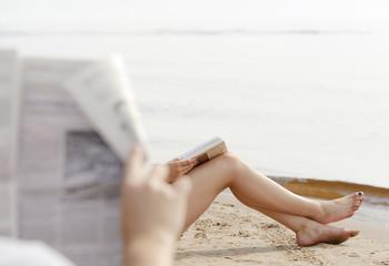 Woman feet in sand on the beach