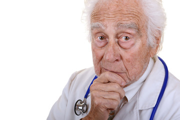 Mature doctor wearing a white lab coat holding his chin