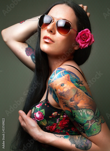 brunette with gorgeous tattoo on her arms.