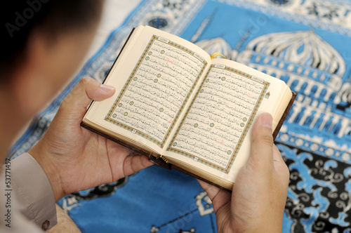 Young Man Reading The Holy Koran