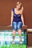 girl taking fish pedicure treatment, rufa garra spa