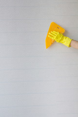 hand smoothing blank wallpaper
