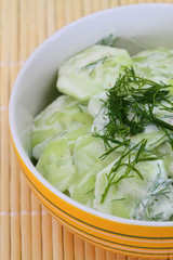 Cucumber salad with sour cream and fresh dill