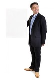 Dapper businessman with blank sign