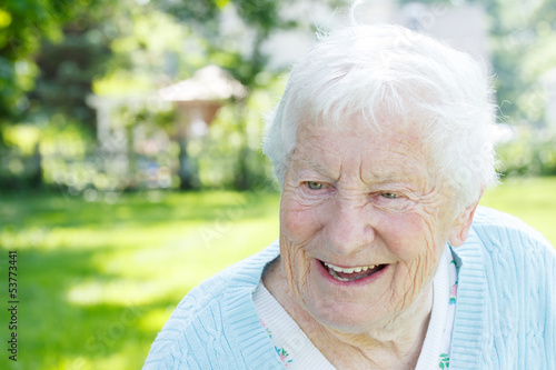 Senior woman in a blue sweater outside