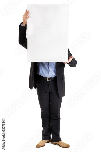 Businessman holding up a blank sign