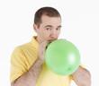 man inflates the balloon