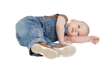child is lying on the floor