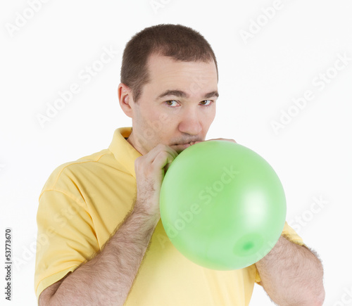 man inflates the balloon