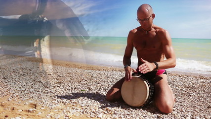 Djembe Drum Player beat rythm on the beach with close up hands