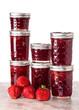 Fresh strawberries preserved in jars