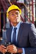 afro american petrochemical businessman with binoculars