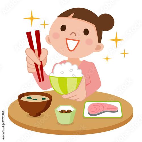 食事中の若い女性