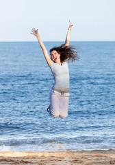Woman jumping on a beach