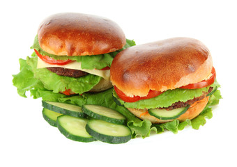 Big and tasty hamburgers on plate isolated on white