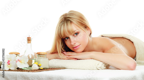 Close-up of relaxed woman in spa center isolated on white