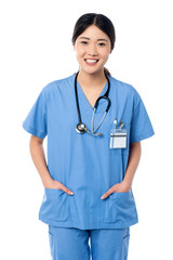 Confident female doctor in medical uniform