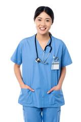 Confident female doctor in medical uniform