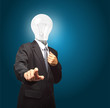 businessman with lamp head push the button on virtual touch pad