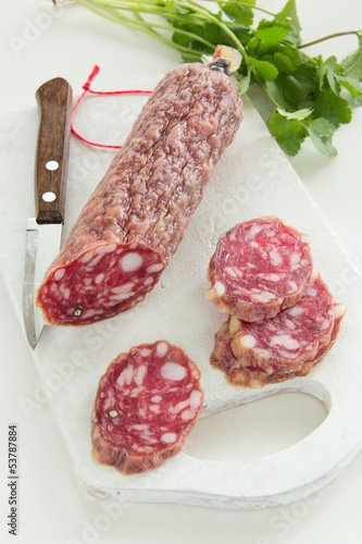 Sliced uncooked jerked sausages.