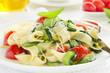 Pasta tagliatelle with zucchini and tomatoes.