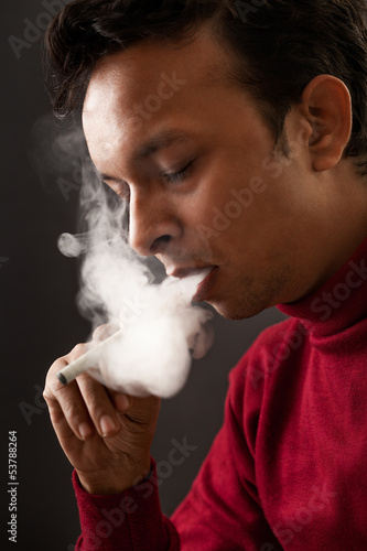 Smoking man using electronic cigarette