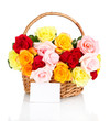 Beautiful bouquet of roses in wicker basket isolated on white