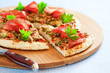 Minced chicken and vegetables pizza, selective focus
