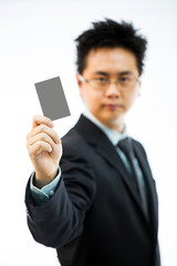 Businessman holding business name card