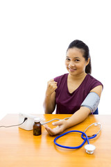 Woman with blood pressure test